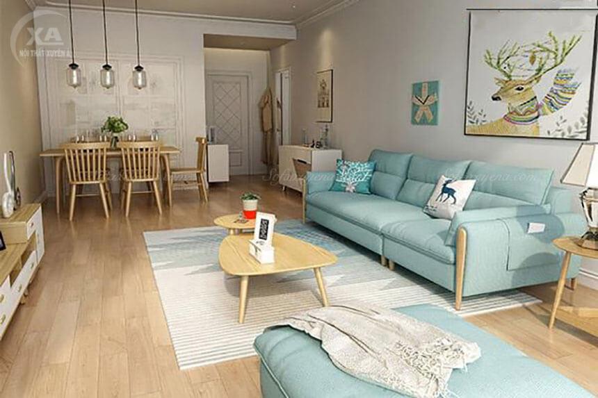 Ghế sofa màu xanh nhẹ nhàng giảm bớt sự bức bối chật hẹp của không gian